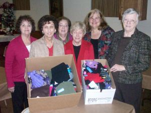 GLCC Women Showcasing Hats and Mittens Donations