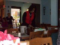 Lisa Moorman cutting birthday cake